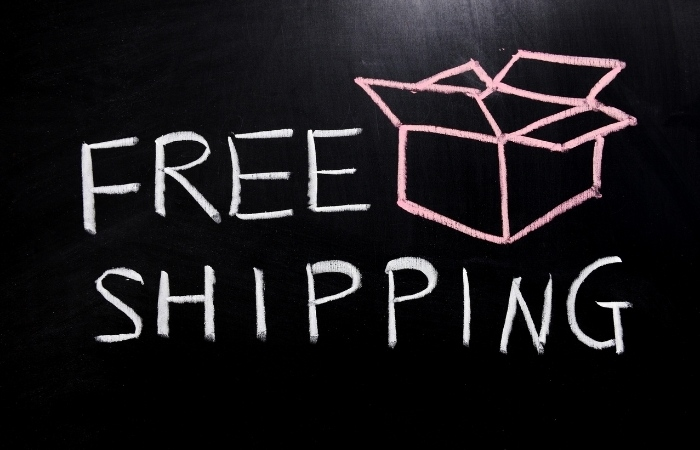 """a chalkboard that reads """"free shipping"""" with a drawing of a cardboard box."""