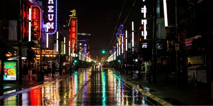 Vancouver with wet roads reflecting the light
