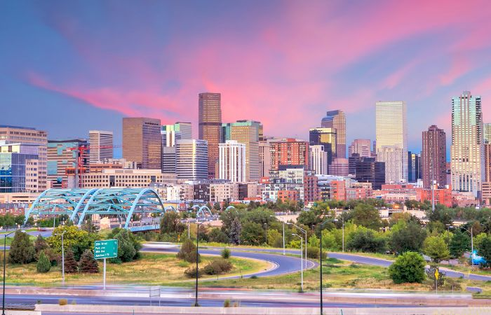 a beautiful photo of the city of Denver with a colorful sky