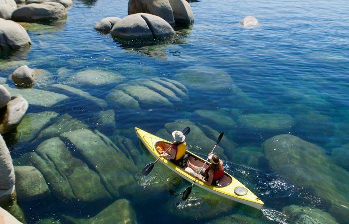 a photo of two people paddling a kayak in Lake Tahoe