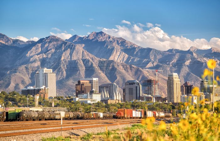 a photo of Salt Lake City with the surrounding mountains in the background