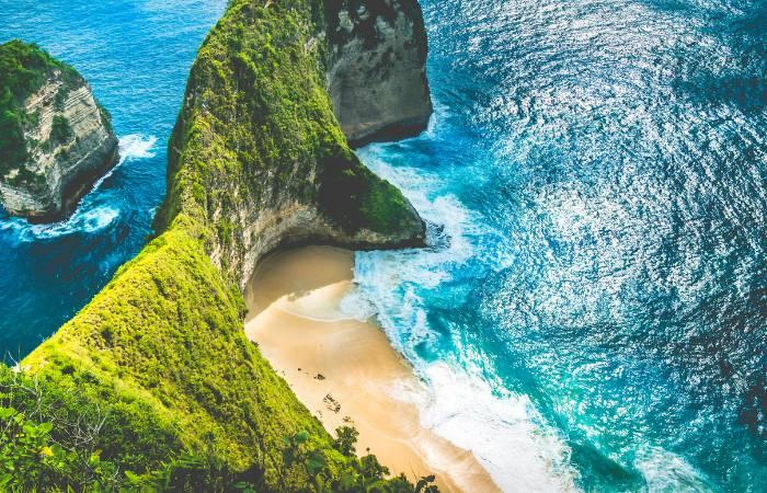 an aerial photo of a beach in Indonesia