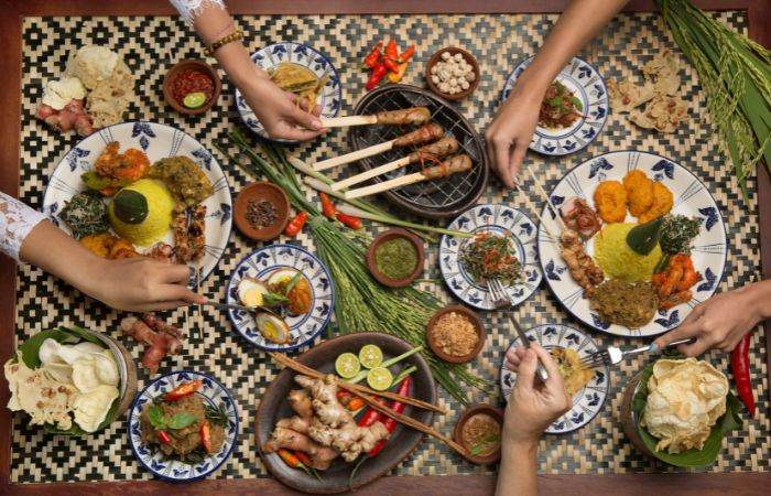 a photo of food in Bali with a variety of different dishes