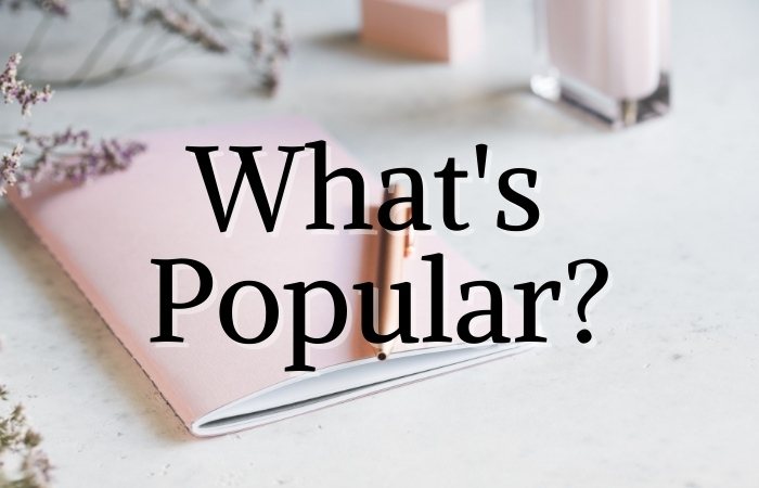 """a book in the background with text overlaying that reads """"what's popular?"""""""