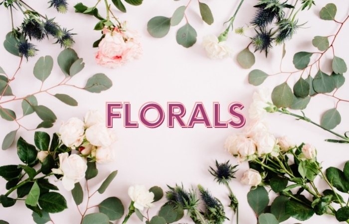 the word floral in pink framed by white flowers on stems