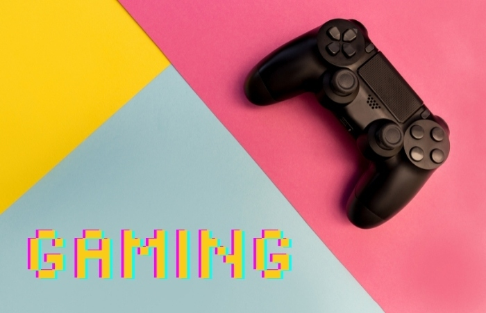 """a game controller in the top right corner with the word """"GAMING"""" in the bottom right corner with a tri colored background of pink, yellow, and grey-blue"""