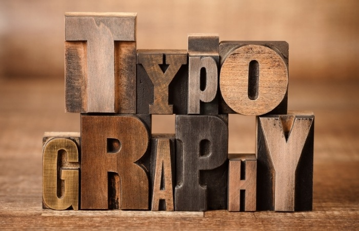 "the word ""TYPOGRAPHY"" displayed on wood blocks"